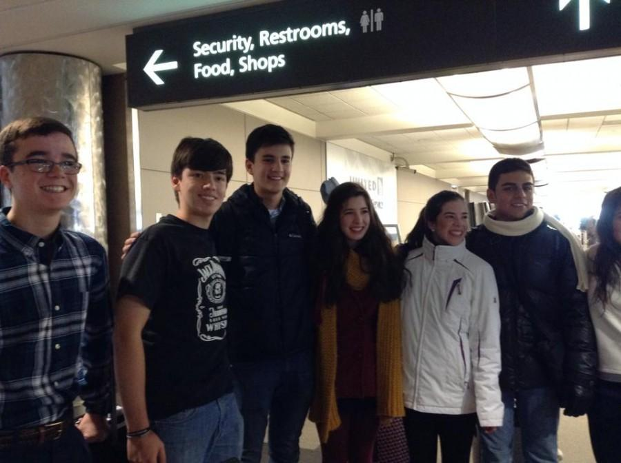 Manolo Padilla (second from the left) poses with his fellow exchange students and host family as he first sets foot on Colorado soil for his Regis Jesuit high school experience.