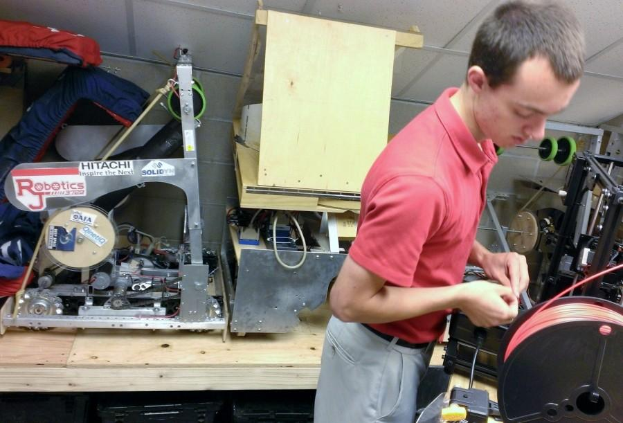 Chris Morroni utilizes the new tools available to the robotics team in the STEM center. Photo by Joe Hamburg.