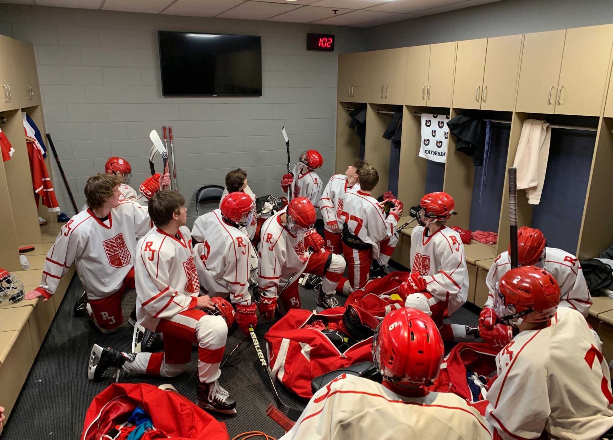 Regis JV hockey team preparing for state.